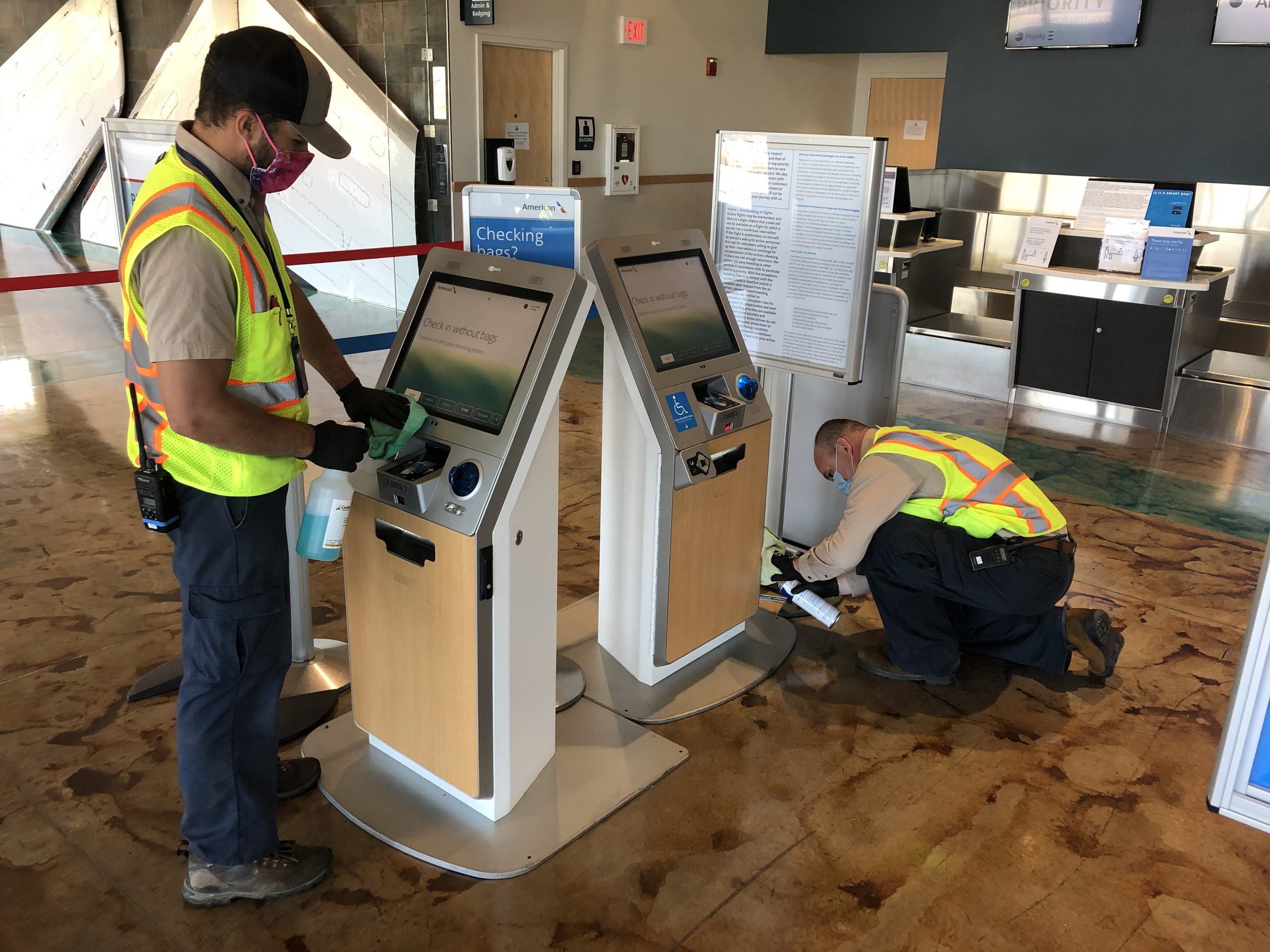 SBP workers cleaning terminal airline kiosks