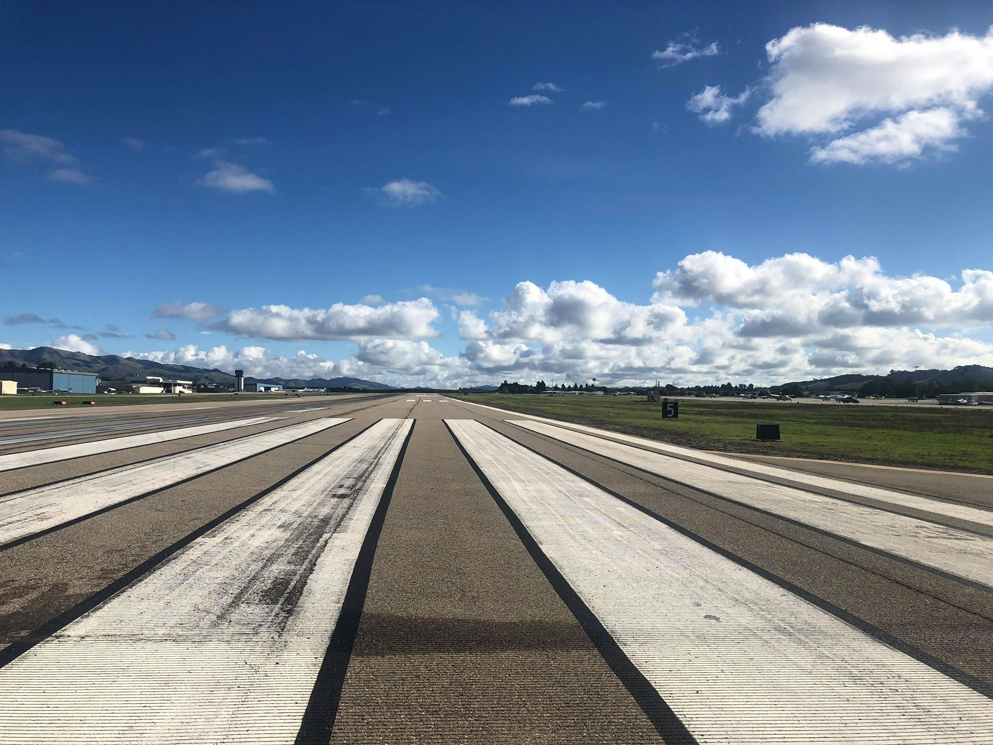 SBP Airport Runway with blue cloudy sky